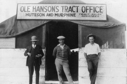 Three men pose for a photograph in 1925 in front of a tent tract office. San Clemente's official birthday is Feb. 8, 1928. Photo: Courtesy of the San Clemente Historical Society