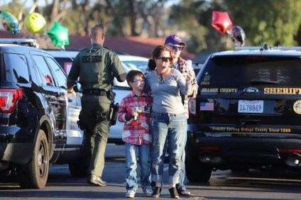 Chase Walters, 10, left, is greeted at Concordia Elementary School on Feb. 5 prior to starting his next series of treatments for leukemia. Photo: Courtesy of OCSD/ Deputy Jeremiah Prescott