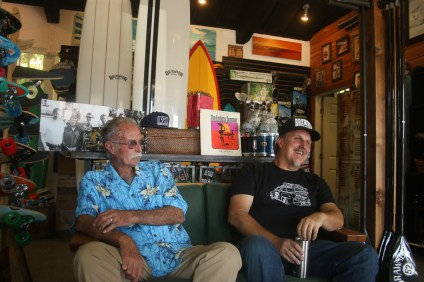 Father and son, Danny, left, and Damian Brawner, share a laugh inside their family surf shop in San Clemente. Photo: Eric Heinz