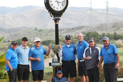 Bella Collina San Clemente team captains Tim Fyffe and Craig Hammer (center) hold the South County Cup trophy after winning the competition between four local courses on April 15. Photo Courtesy Marci Ohmer
