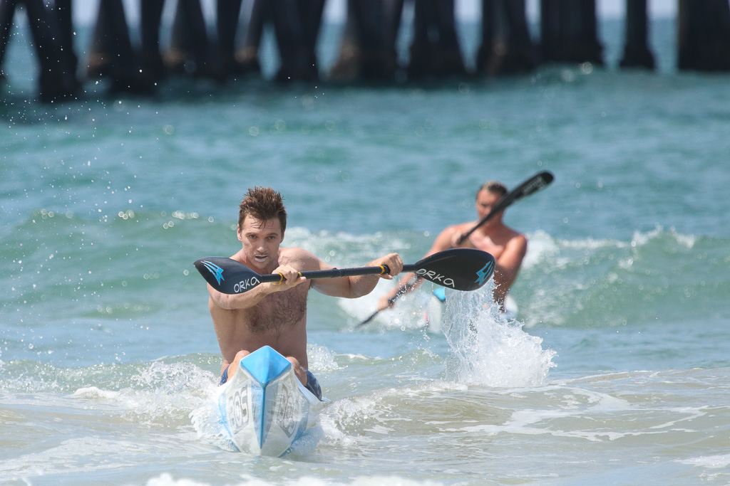 En route to victory, a competitor eyes the finish line during the surf ski competition on Saturday, July 21, at the San Clemente Ocean Festival. Photo: Eric Heinz