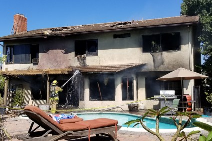 OCFA firefighters extinguish a house fire on Monday, Sept. 17, on the 600 block of Calle Juarez. OCFA has not yet released its findings into what may have caused the fire. Photo: Courtesy