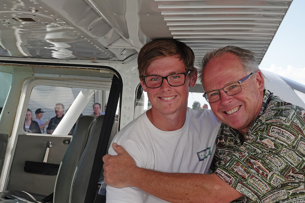 Patrick Economy, 16, with his father, Federal Aviation Administration inspector Scott Economy, after the teen completed three solo takeoffs and landings Sunday at John Wayne Airport. Photo: Fred Swegles