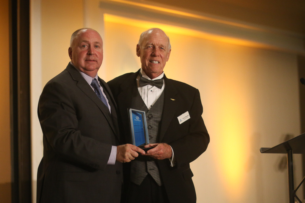 CEO Terry Hughes of the BGSCA, left, awards Board President Larry Rannals with the Blue Door Award for outstanding leadership at the Great Futures Gala on Saturday, Oct. 20. Photo: Eric Heinz