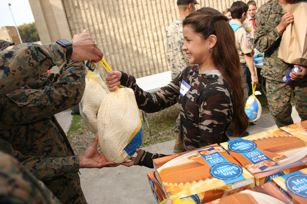 Boy Scouts and family members also participated in helping with the distribution of Thanksgiving dinners on Monday, Nov. 19, at Camp Pendleton. Photo: Eric Heinz