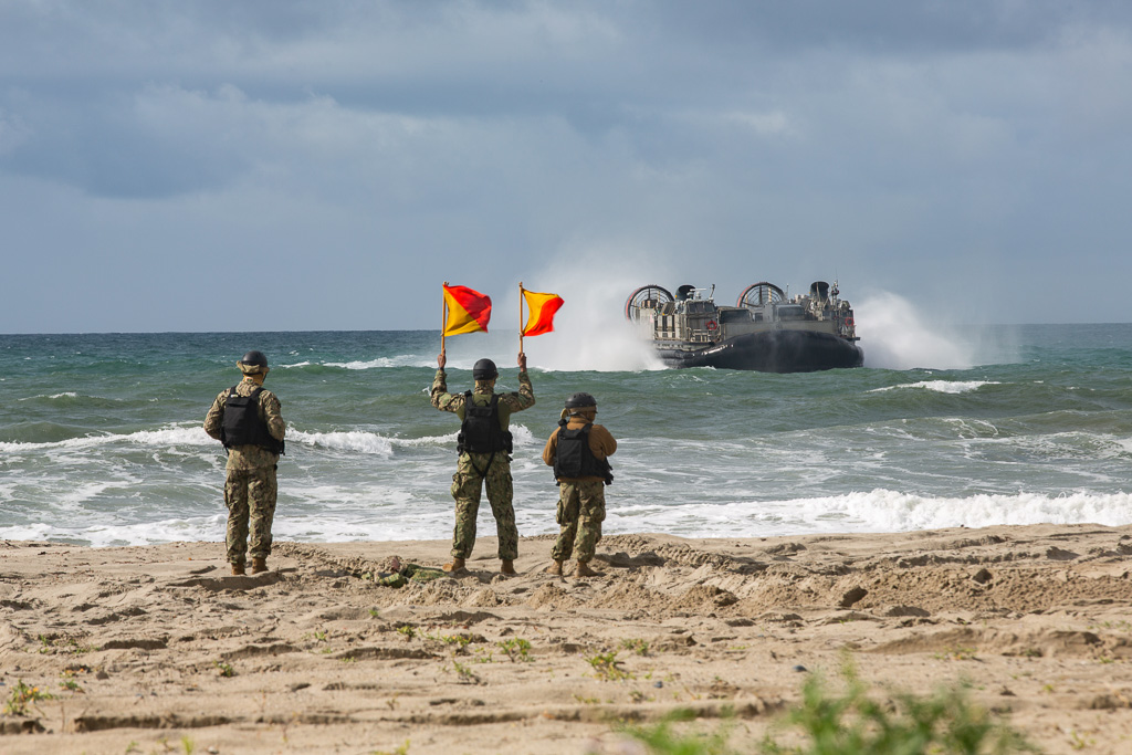 U.S. Sailors give the go-ahead for a landing aircraft to come ashore so Japan Ground Self-Defense Force (JGSDF) Soldiers with 1st Amphibious Rapid Deployment Regiment can offload vehicles during an amphibious landing exercise for Iron Fist 2019, Feb. 4, on U.S. Marine Corps Base Camp Pendleton.  Photo: U.S. Marine Corps /Cpl. Cutler Brice