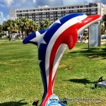 Patriotic Dolphin sports Red white and blue at Pier 60 Clearwater Beach Florida