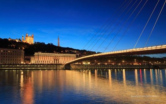 Night view over the Saone river to the Fourviere cathedral.