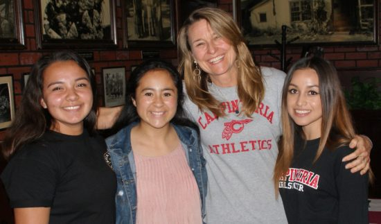 Assistant coach Lucy Carleton is joined by Carpinteria girls soccer players, from left, Yaneli Gutierrez, Alejandra Alvarez and Aisha Duarte.