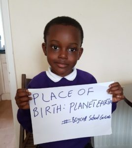 "Picture of 5 year old boy holding sign saying ""Place of Birth: Planet Earth #BoycottSchoolCensus"""