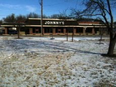 Johnny's Market borders one of the three sides of Sappington-Concord Memorial Park.