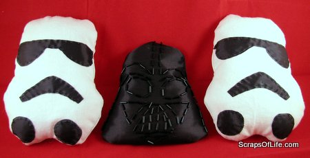 2 storm trooper stuffed figures and a darth vader bean bag toy