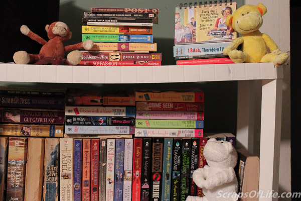 On a temporary shelving unit with some of my paperbacks are this trip of pint sized monkeys.