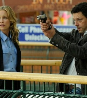 Piper Perabo as Annie Walker, Richard Coyle as Simon Fischer -- (Photo by: Steve Wilkie/USA Network)