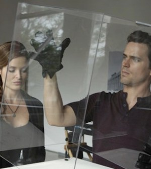 Gloria Votsis and Matt Bomer on WHITE COLLAR -- (Photo by: Giovanni Rufino/USA Network)