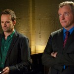 Jonny Lee Miller and Aidan Quinn in Elementary. Image © CBS