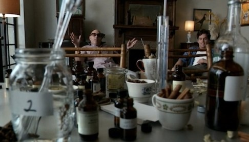 Mozzie (Willie Garson) helps Neal (Matt Bomer) with the delicate art of whiskey counterfeiting (Image © USA Network)