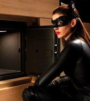 Anne Hathaway's Cat Woman cracks Bruce Wayne's safe in The Dark Knight Rises. Image © Warner Bros