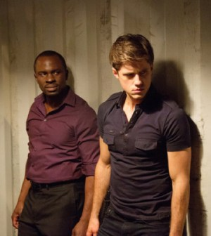 Pictured: (l-r) Gbenga Akinnagbe as Bello, Aaron Tveit as Mike Warren -- (Photo by: Bob Mahoney/USA Network)