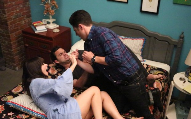 Schmidt ties to get between Nick and Jess. Literally. (L-R) Zooey Deschanel as Jess, Jake Johnson as Nick, Max Greenfield as Schmidt. Image © FOX