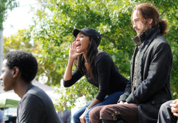 "Abbie Mills (NIcole Beharie, L) brings Ichabod Crane (Tom Mison, R) to a town baseball game in ""The Sin Eater"" episode of Sleepy Hollow. Co. CR: Brownie Harris/FOX"