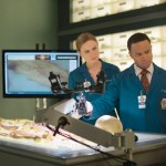 """BONES:  Brennan (Emily Deschanel, L) and Dr. Clark Edison (guest star Eugene Byrd, R) examine remains of a professional sailor in the """"The Ghost in the Killer"""" episode of Bones. Co.  Cr:  Jordin Althaus/FOX"""