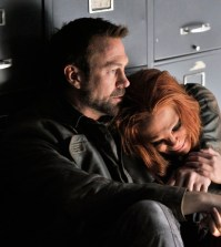 Pictured: (l-r) Grant Bowler as Joshua Nolan, Stephanie Leonidas as Irisa Nolan -- (Photo by: Ben Mark Holzberg/Syfy).