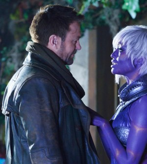 "DEFIANCE -- ""Where the Apples Fell"" Episode 306 -- Pictured: (l-r) Grant Bowler as Joshua Nolan, Nichole Galicia as Kindzi -- (Photo by: Ben Mark Holzberg/Syfy)"
