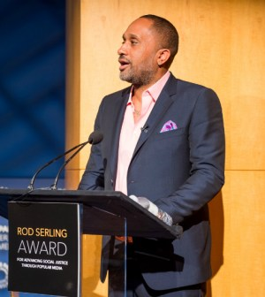 Kenya Barris accepts the Rod Serling Award. (Photo by Jake West for Ithaca College)