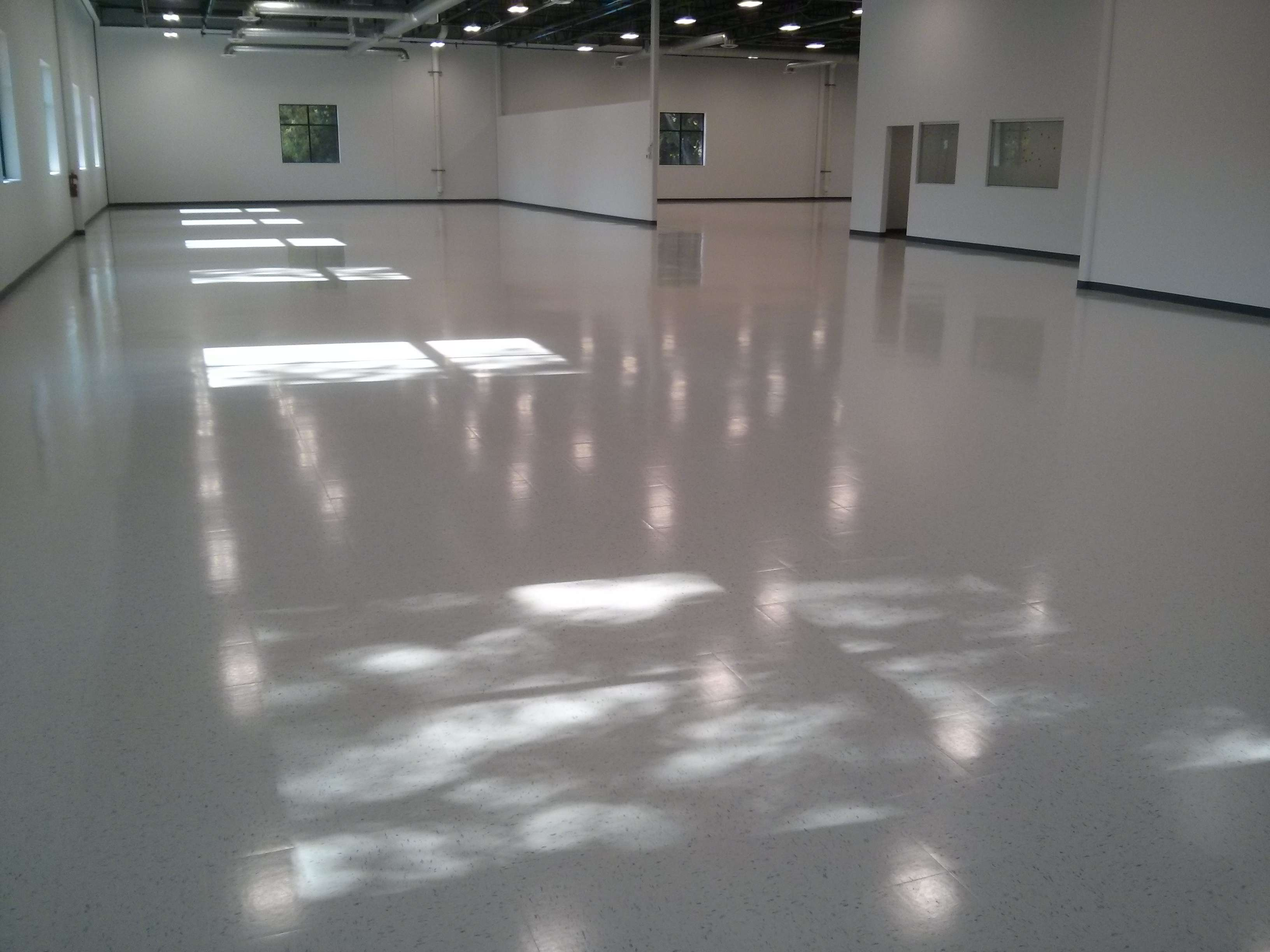 New construction vct vinyl tile floor cleaning sealing for Floor finishes