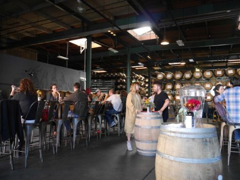 Wide open tasting room with high ceilings.