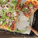 Pork Ragu Pizza with Ricotta Salata and Arugula