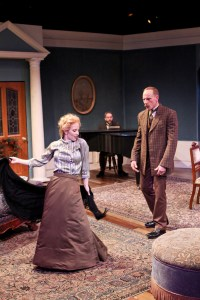 "Jennifer Sue Johnson as Nora and Michael Patten as Torvald in Seattle Shakespeare Company's 2013 production of ""A Doll's House."" Photo by John Ulman."