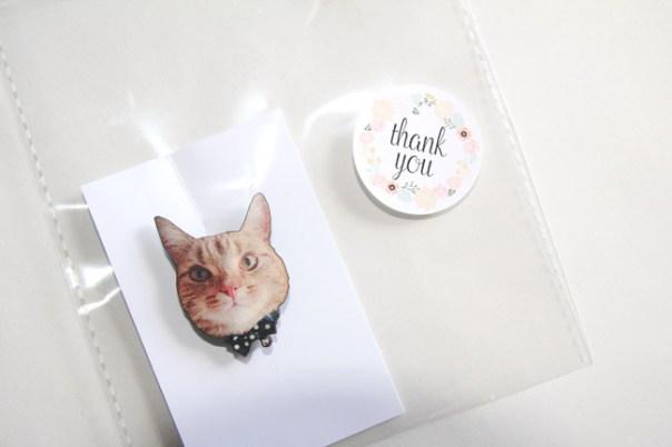 cat badge in bag