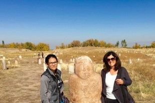 My sweet mom and I standing next to a Balbal near Burana Tower in Kyrgyzstan