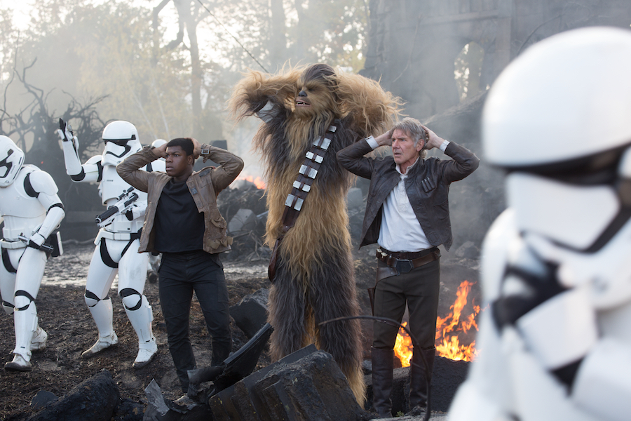 Star Wars: The Force Awakens..L to R: Finn (John Boyega), Chewbacca (Peter Mayhew), and Han Solo (Harrison Ford)..Ph: David James..© 2015 Lucasfilm Ltd. & TM. All Right Reserved.