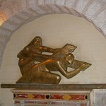 Fifth Station: Relief showing Simon of Cyrene helping to carry the cross (Seetheholyland.net)