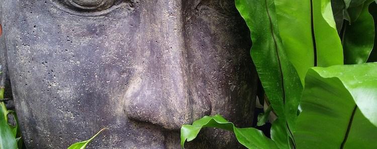 zen-statue-face-foliage