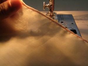 Trim the seam allowance very close to the stitching.