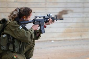 IDF female combat soldier during live fire exercise.