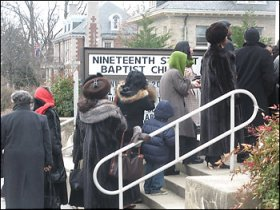 Members of the 19th Street Baptist Church in Washington, D.C., who have been praying the Obamas would join them, enter the church eager to see the Obama family, who have come to visit.  Photo: Hamil Harris, Washington Post