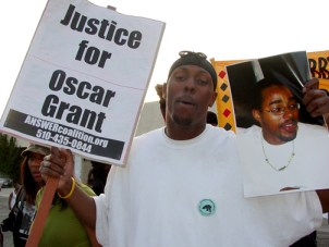 This marcher connected the dots between the police murders of Oscar Grant on Jan. 1 and Lovelle Mixon on March 21.  Photo: Dave Id, Indybay