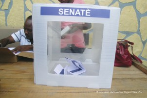A nearly empty ballot box sits at a polling station in Port-au-Prince on April 19, 2009. Voters overwhelmingly stayed away from the polls after Haiti's largest political party called for a boycott. - Photo: © 2009 Haiti Information Project, Jean Ristil