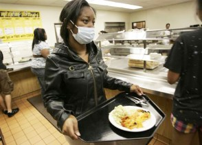 Freshman Lasaundra Thompson of Oakland gets dinner at a student dining hall Wednesday on the California State University Long Beach campus, where a possible swine flu patient complained of symptoms. - Photo: Branimir Kvartuc, AP