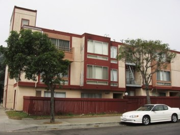 Located back to back, the King Garvey Co-op and the Fillmore Center are like night and day. In one live residents with a vision of cooperation and self-sufficiency who have struggled for almost 30 years to achieve their goal of home ownership. In the other lies a vision set forth by developers that is taking over San Francisco, one of expensive high-rise condos affordable to a select elite. – Photo: Chris Brizzard