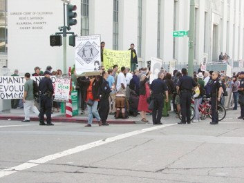 Outside the courthouse on the first day of killer cop Johannes Mehserle's preliminary hearing, May 18, protesters watched the cops and the cops watched the protesters. – Photo: Dave Id, Indybay