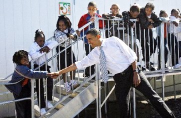 When Barack Obama visited New Orleans in February 2008, he got a big cheer when he mocked President George W. Bush's initial flyover to view Katrina's destruction in 2005. Here, Obama is shown greeting students at George Washington Carver Elementary School during that 2008 visit. The Times-Picayune reports he is not expected to return to mark the fourth anniversary of the flood this Aug. 29. – Photo: Ted Jackson, Times-Picayune archive