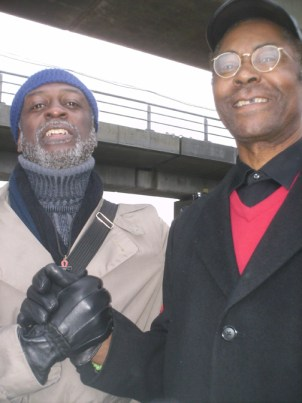 In Copenhagen, Baba Jahahara poses with Dr. Henry Clark of West County Toxics Coalition, a pioneering environmental justice organization he founded in Richmond, Calif.