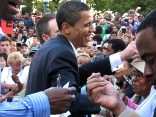 Barack Obama dives into the happy crowd – more than 10,000 according to major media – Saturday in front of Oakland City Hall. – Photo: Wanda Sabir