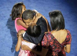Sasha and Malia Obama are locked in a hug with their Dad on Aug. 28, 2008, after he accepted the nomination for president of the United States as Mom looks on.